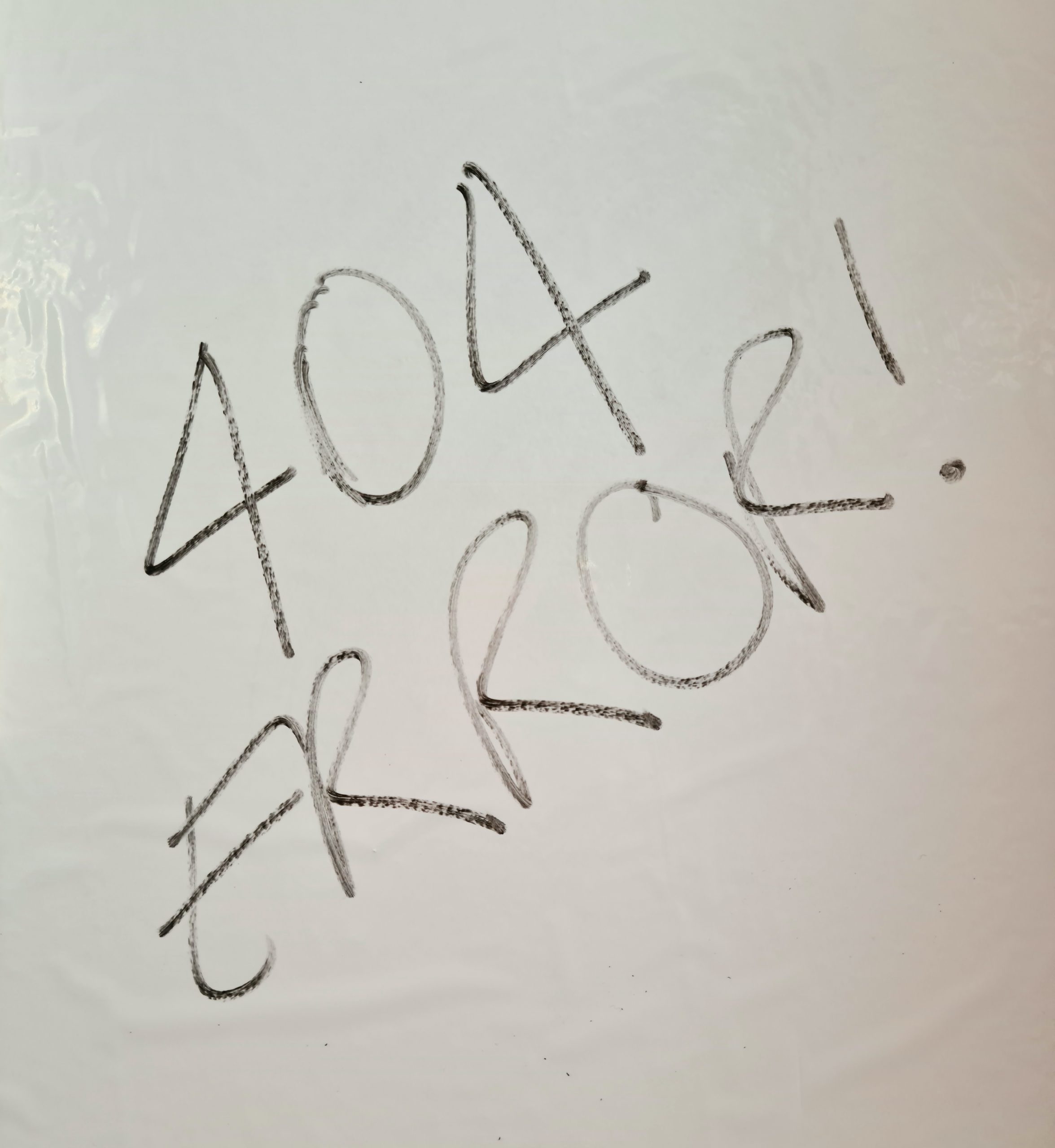 "404 error - page not found. Photograph of words on whiteboard saying ""404 error"""
