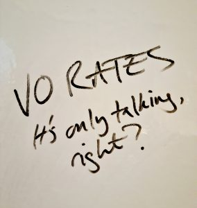 Photograph of words on whiteboard: VO rates - it's only talking, right?