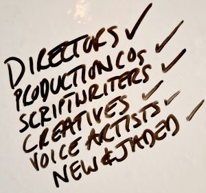 Photograph of words on whiteboard: List with ticks alongside: directors, production companies, scriptwriters, creatives, voice artists, new and jaded